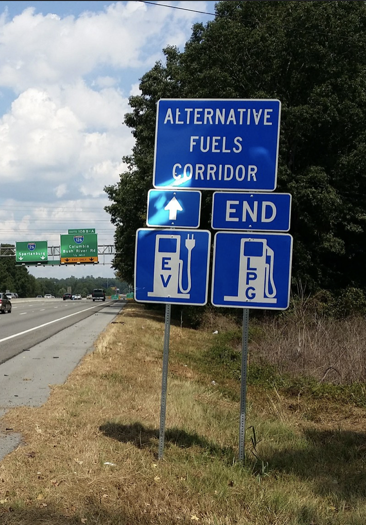 Alt Fuels corridor signage next to interstate